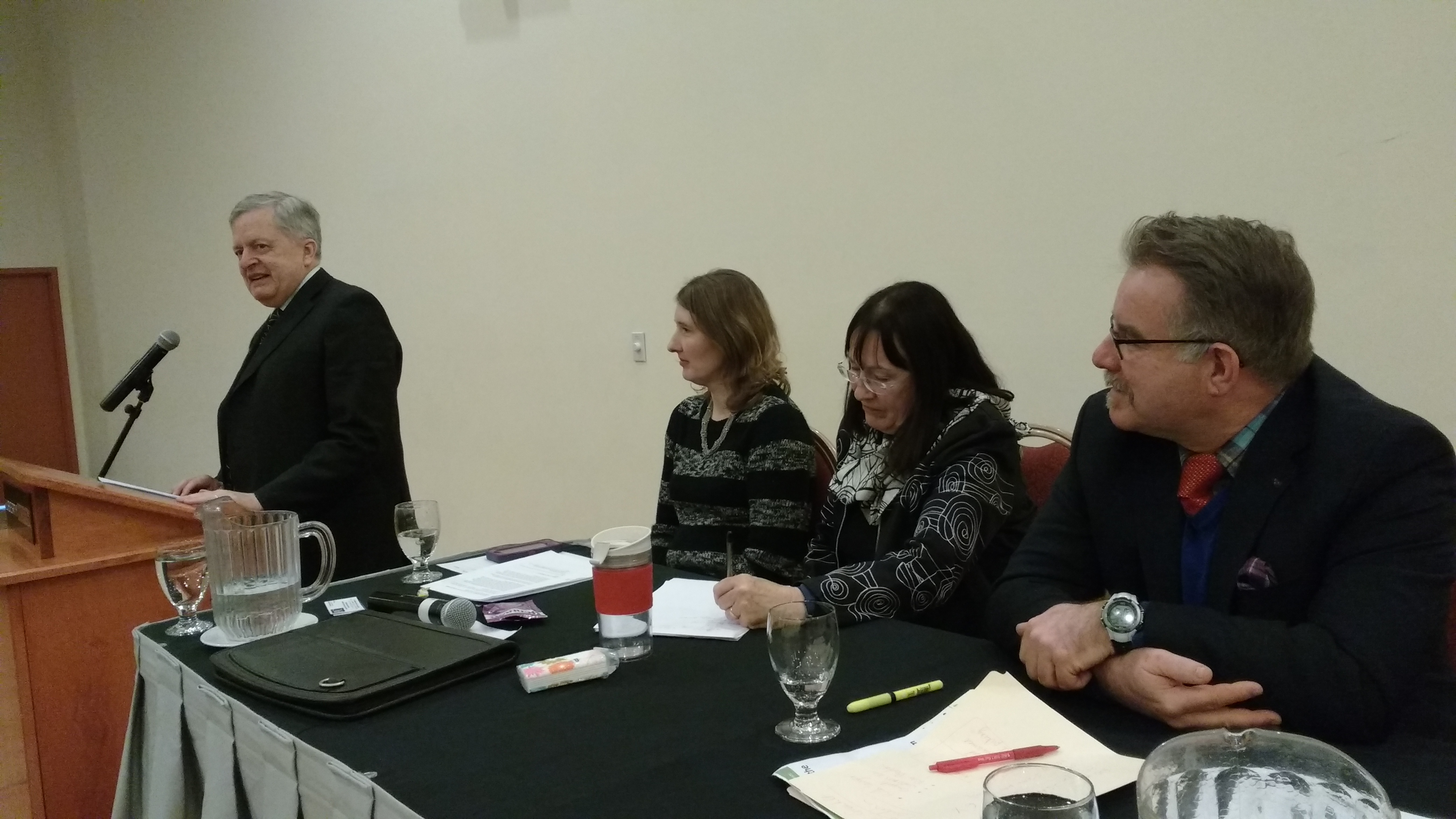Oakville Mayor Rob Burton, meeting chair Margaret Prophet, panelists Connie Spek and David Donnelly -AWARE Simcoe photo
