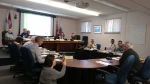 William Shotyk, right, addresses Tiny Township Council. Vickie Monague of Beausoleil First Nation, known for her role in stopping Dump Site 41, is at left, live streaming the presentation. -AWARE Simcoe photo