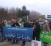 Ontario Green Party leader Mike Schreiner and Simcoe North Green candidate Valierie Powell join water protectors at the Teedon Pit