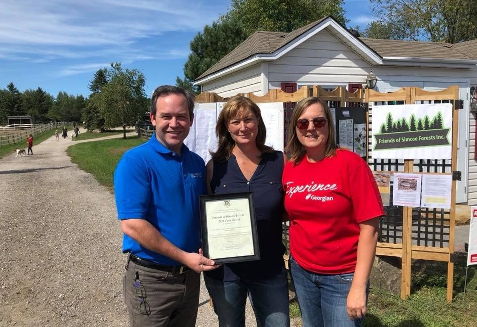 MPP Doug Downey with Karen White, owner of Bridle Tree Farm, and Cindy Mercer of Friends of Simcoe Forests.