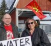 Dave Stock and Beth Brass Elson after flag is raised at the Elmvale flow. -AWARE Simcoe photo