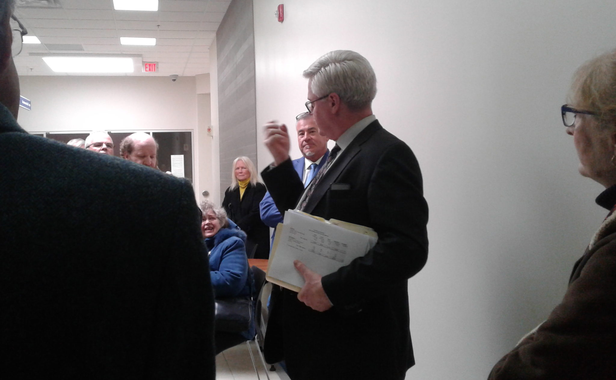 Lawyer Phil Horgan, centre, answers questions. AWARE Simcoe photo
