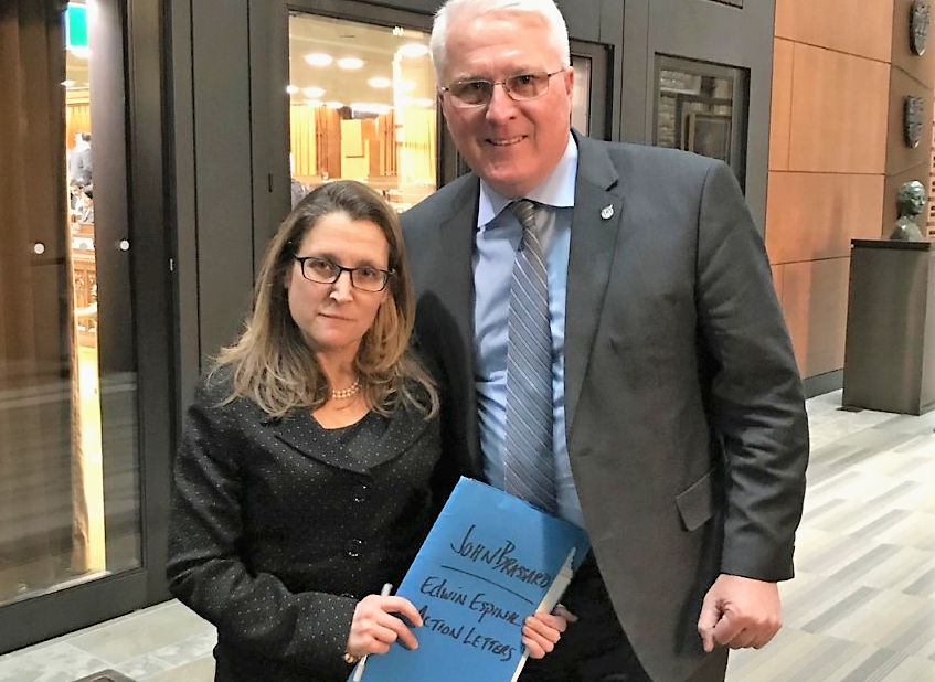 Foreign Affairs Minister Chrystia Freeland receives letters written by Innisdale Collegiate students in support of Edwin Espinal from Barrie-Innisfil MP John Brassard.