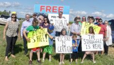 Celebration by Highway 92 in front of the political prisoners sign. -AWARE Simcoe photo