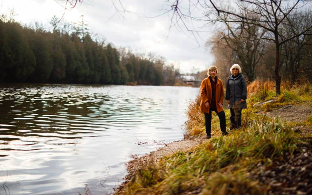Donna McCaw and Jan Beveridge by the Grand River in Elora